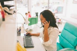 A business women on the phone to her digital marketing agency